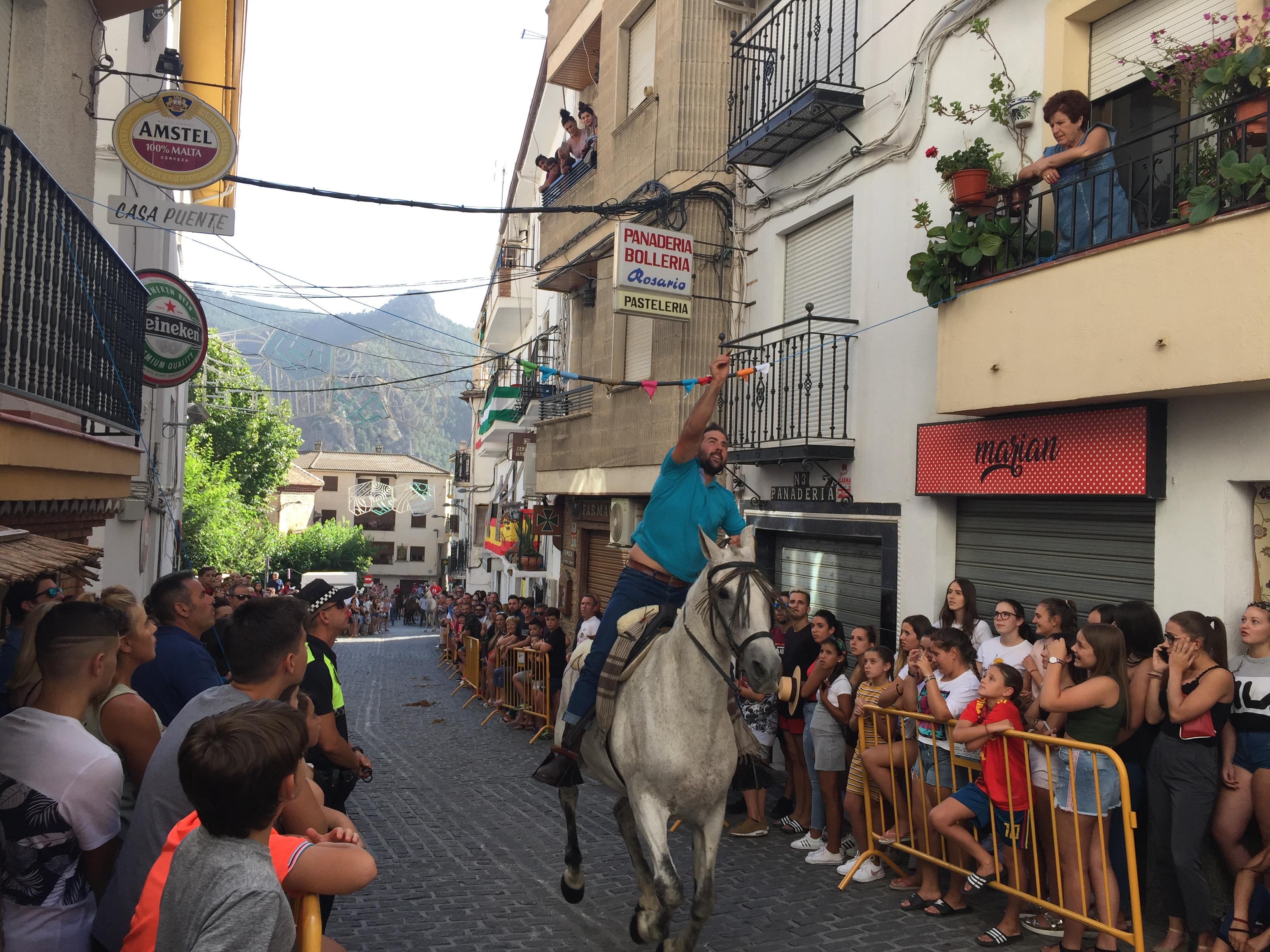 Carrera cintas caballos